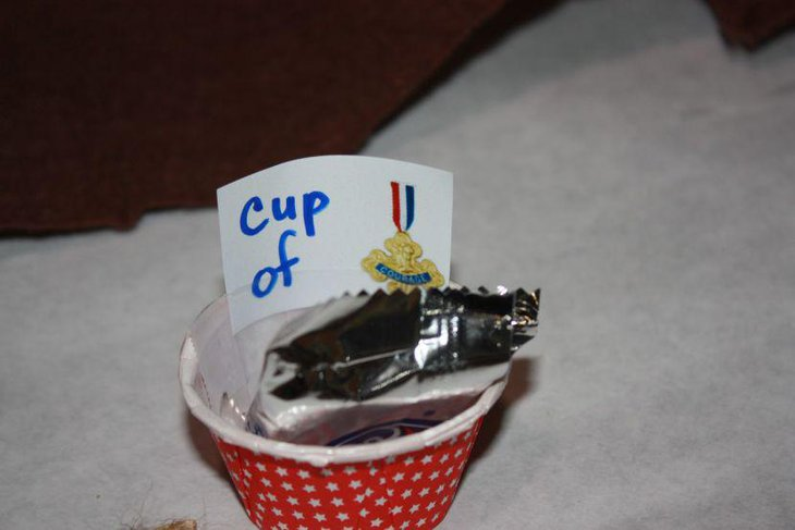 Cup of Courage favor cup on retirement party table