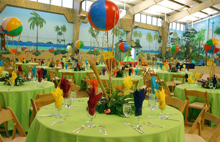 Cute beach party table decor with colourful ball centerpieces