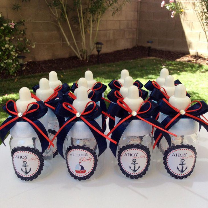 Cute blue and white nautical baby shower table decor with bottles