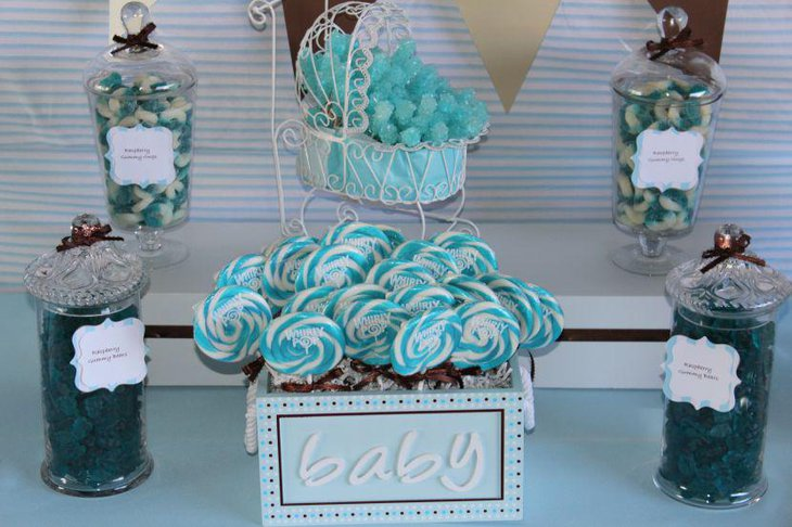 Cute blue baby shower candy table with whirly pops in blue accents