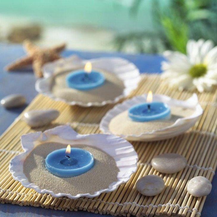 Cute blue candles on shell wedding centerpieces