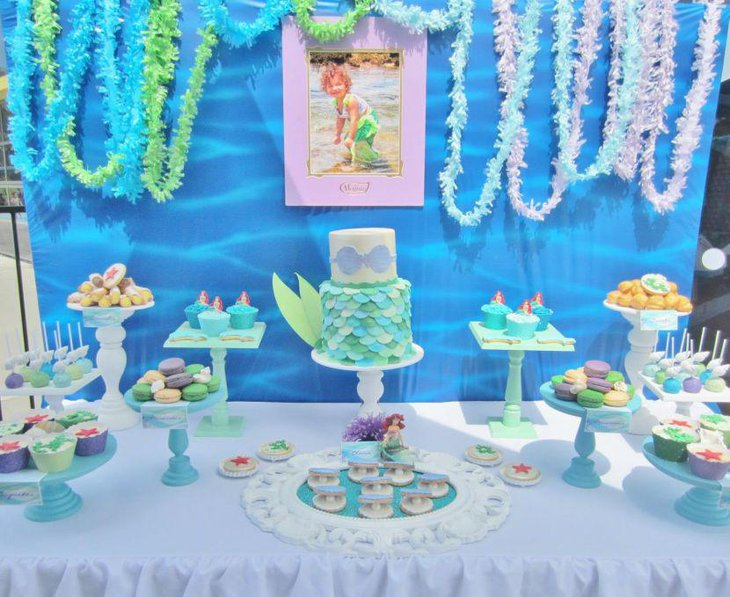 Cute blue candy table for mermaid themed birthday party