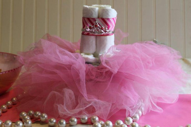 Cute DIY diaper tutu cake centerpiece decoration on girl baby shower table