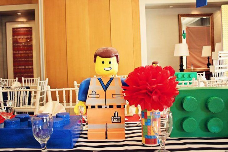 Cute Emmet and Lego blocks as birthday party table decorations