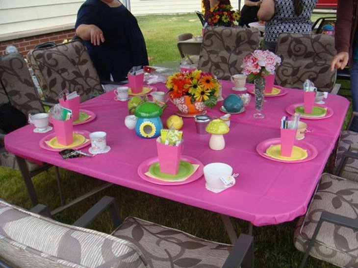 Cute floral centerpiece on girl baby shower table