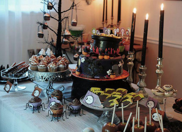 Cute Halloween Table Decoration With Black Candles and Yummy Deserts