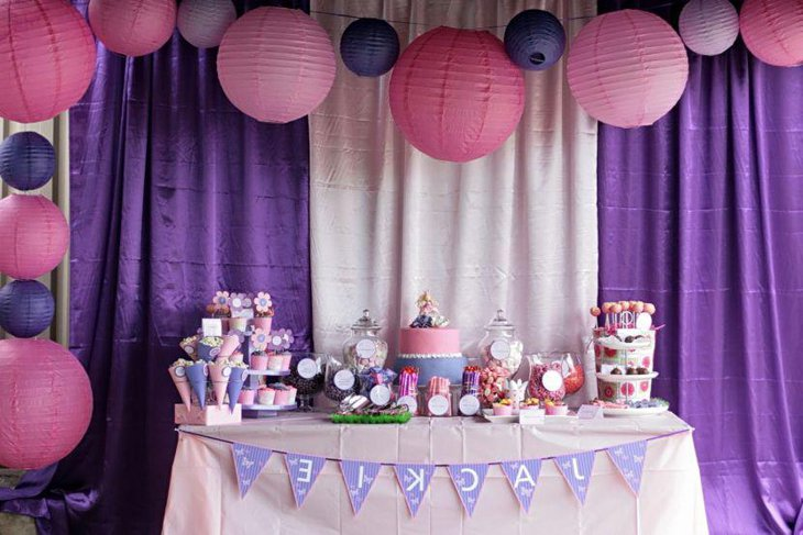 Cute kids birthday party table decor with purple tones