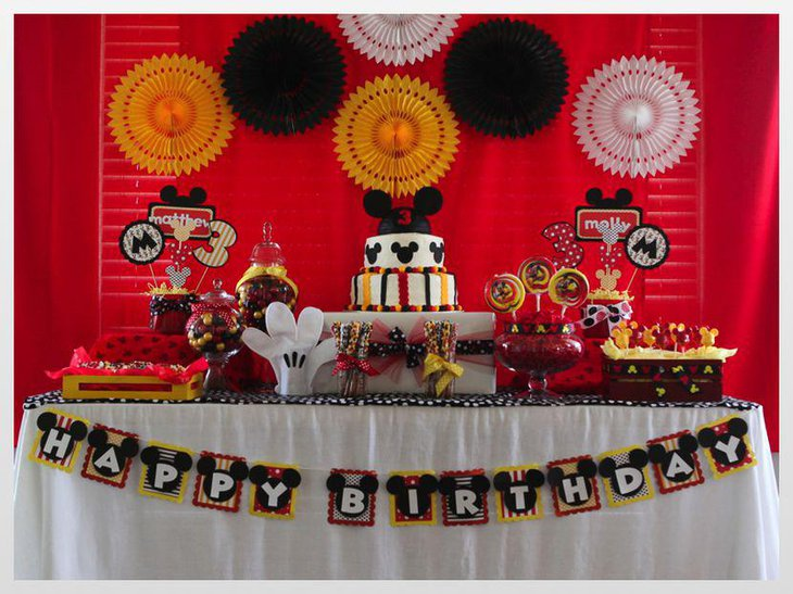 Cute Mickey Mouse Table Decoration With Mickey Cake And Buntings