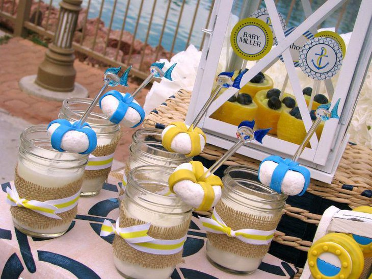 Cute nautical baby shower table decor with jars and DIY lifesavers