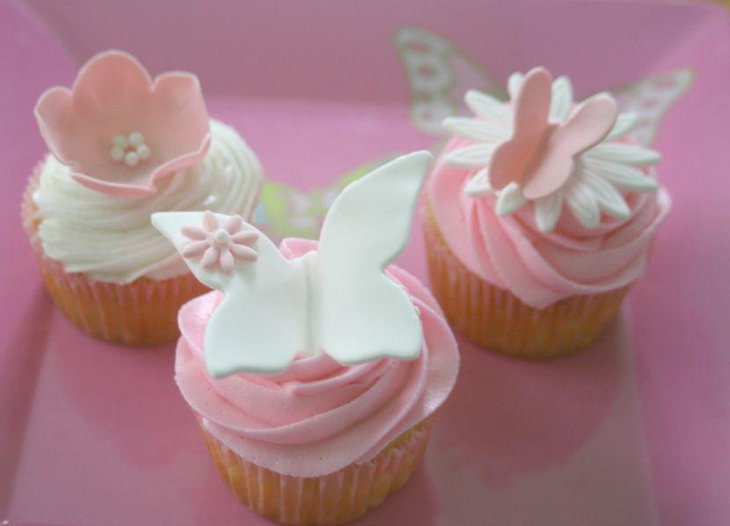 Cute pastel butterfly themed cupcakes for baby shower