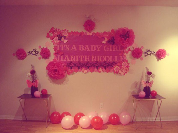 Cute pink butterfly and flower themed girl baby shower decor