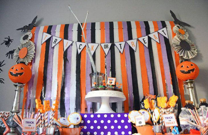 Cute Pumpkins on silver stands for kids Halloween treats table