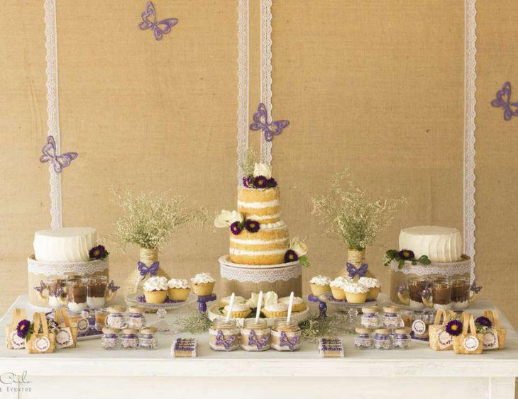Cute purple butterfly decorations on baby shower table