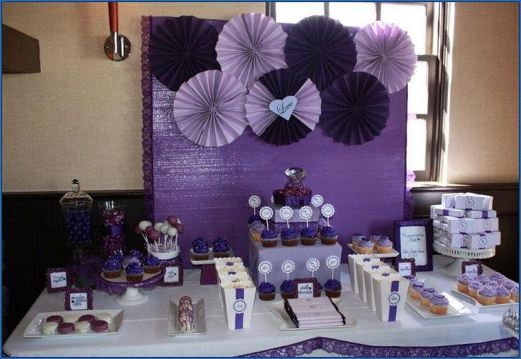 Cute purple themed girl baby shower table decor and backdrop