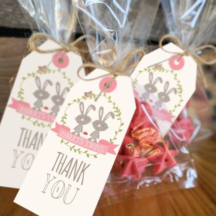 Cute thank you favor packets displayed for a twin baby shower