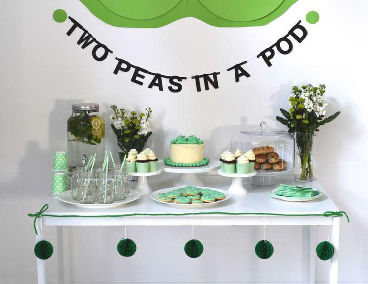 Cute two peas in a pod themed baby shower table in green accents