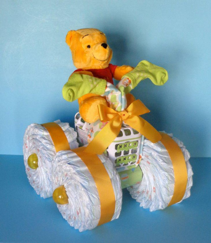 Cute Winnie The Pooh diaper cake centerpiece for baby shower