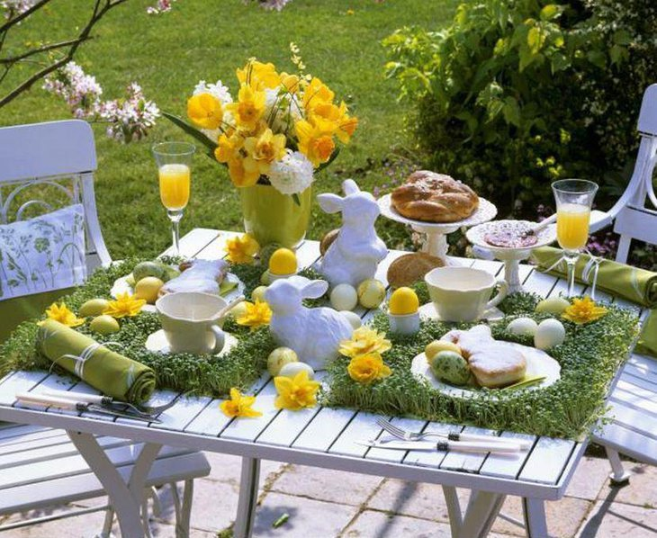 Cute yellow floral arrangement on spring garden party table