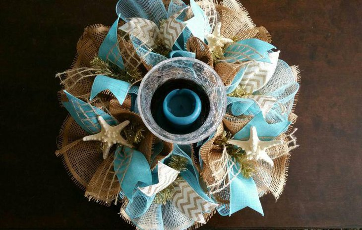Deco mesh and burlap wedding table centerpiece with a beach theme