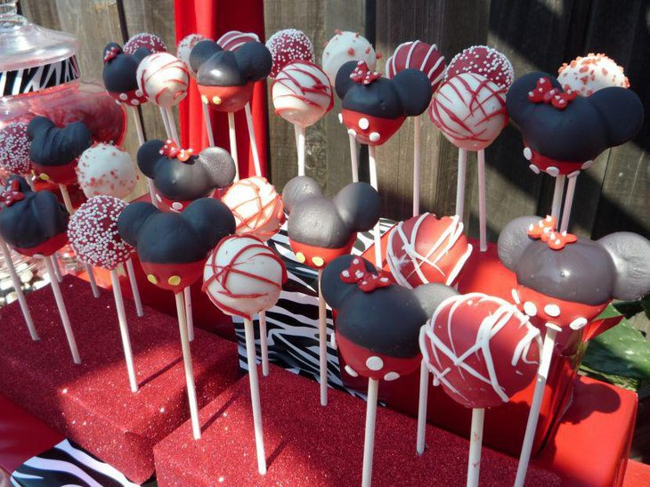 Delicious Minnie Mouse cake pops on candy table