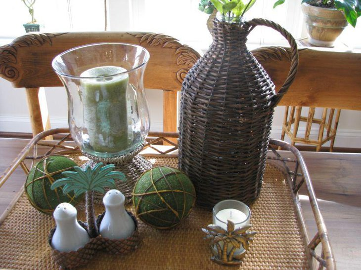 Demijohn vignette with glass candle jar and green balls