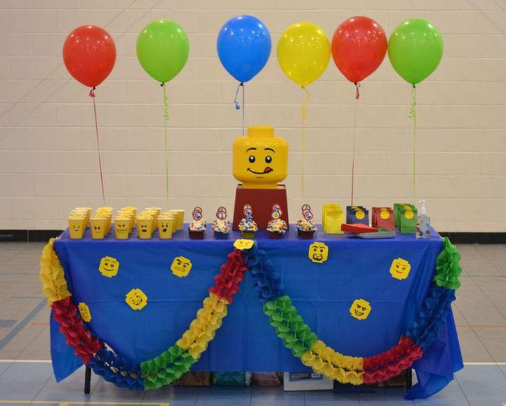 DIY Lego themed party table with Lego face embossed paper cups