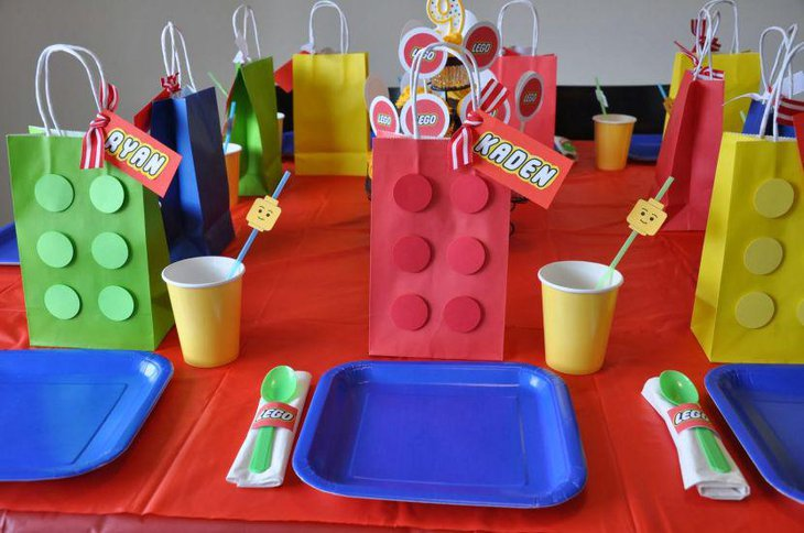 DIY Lego themed table decor with colourful paper bags and Lego head staws