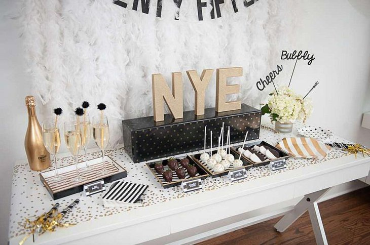 DIY New Year Table Decoration with White Flowers Chocolates and Champagne