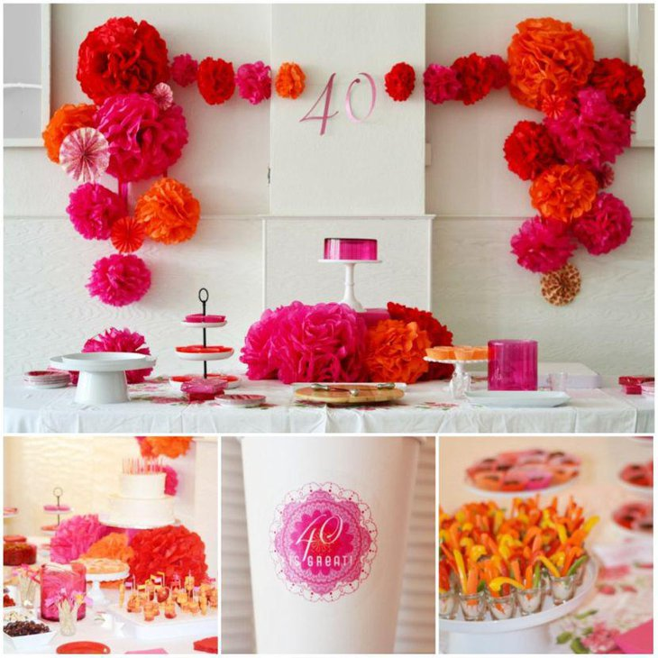 DIY pink orange and red flower arrangement on party table