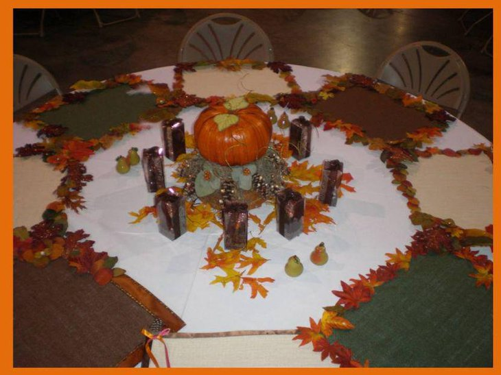 DIY table decoration with pumpkin and maple leaves