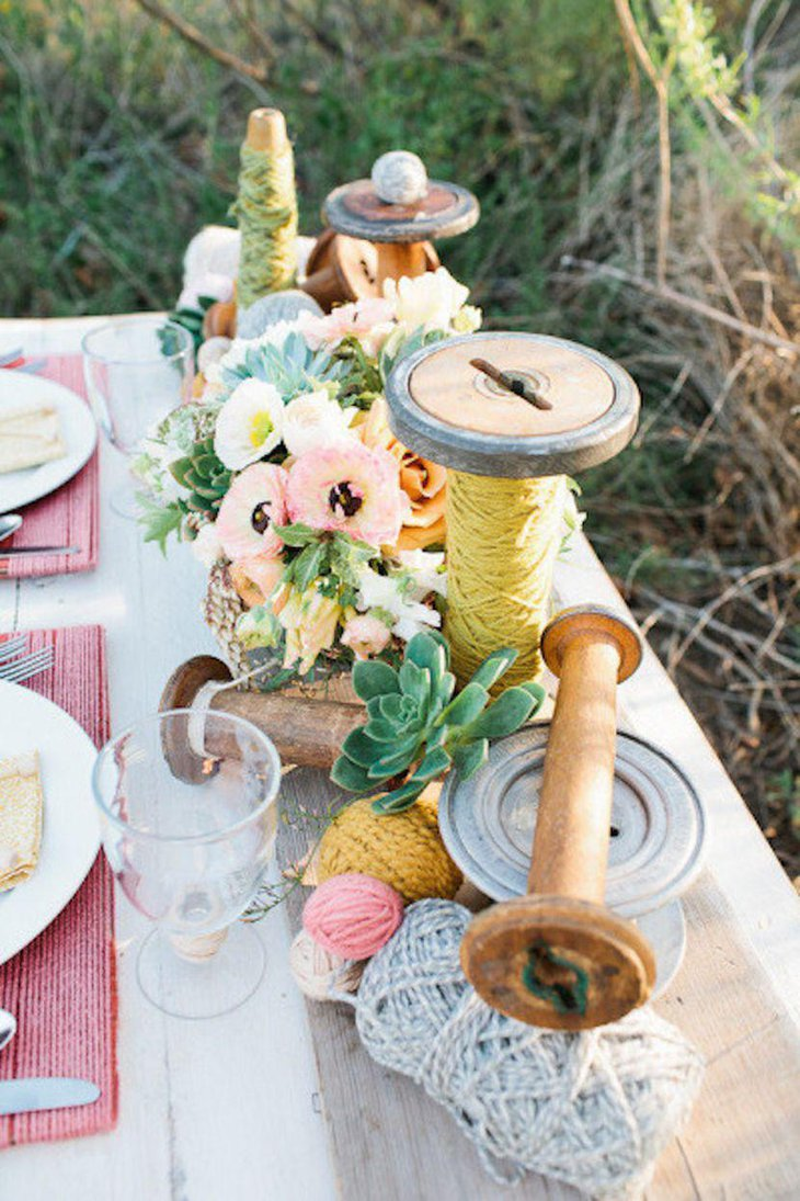 DIY Wooden Spool With Yarn Balls As Wedding Table Centerpiece