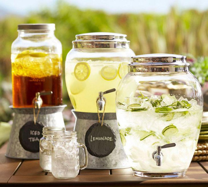Drinks table setup with beverages and coolers served in mason jars