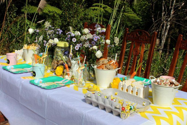 Easter garden party table decor with yellow and white table runner