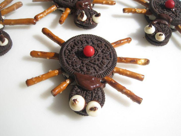 Edible black widow spider decorations on kids Halloween table