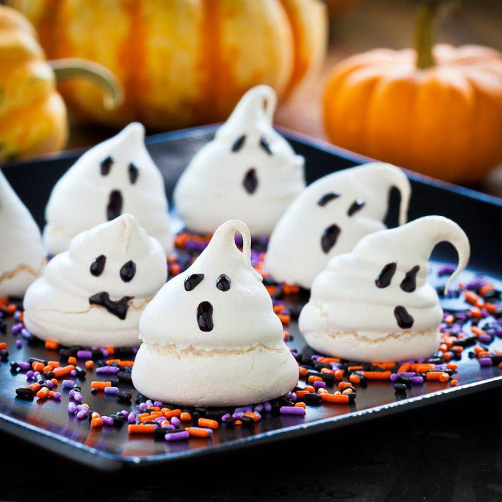 Edible chocolate ghosts on tray decorations on kids Halloween table