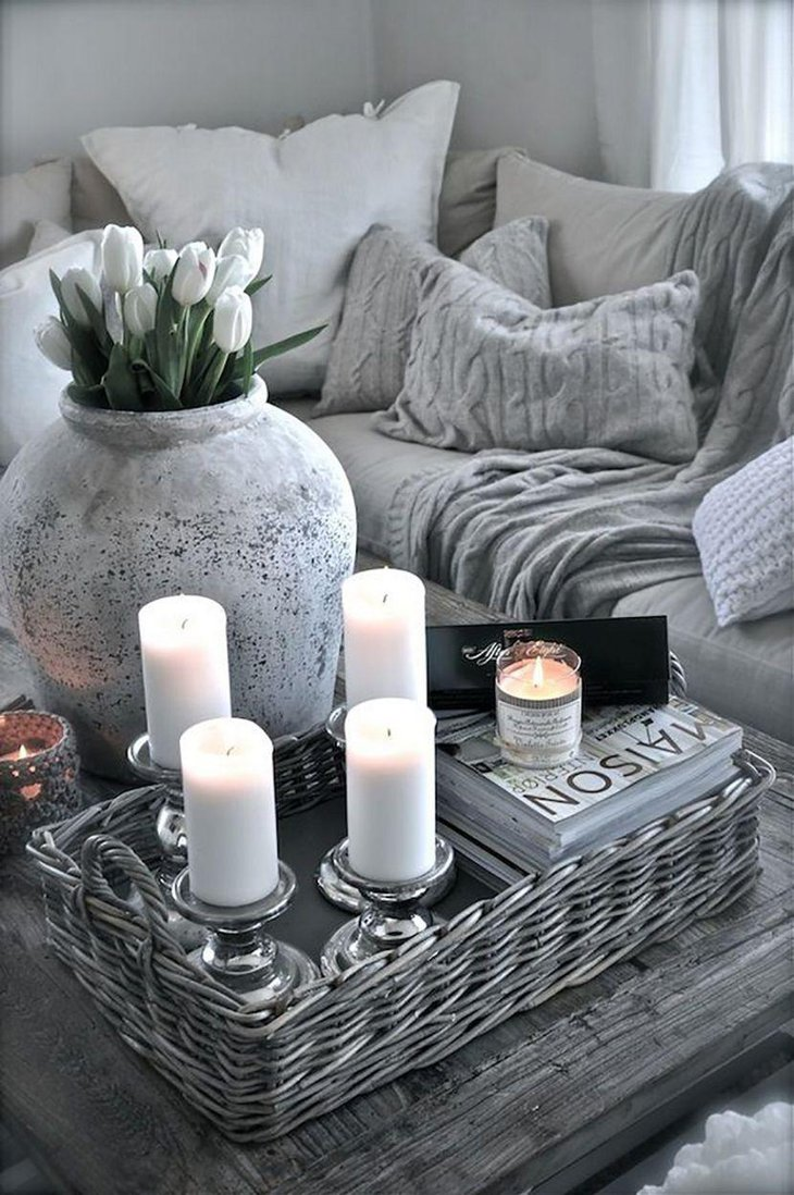 Elegant candleholders and rattan tray decor on coffee table