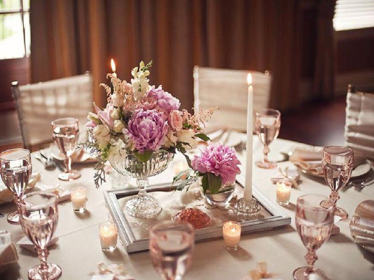 Elegant pink and white floral centerpiece for wedding tables