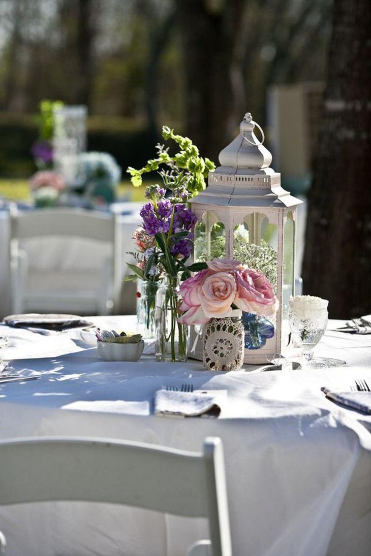 Elegant vintage lantern decoration on wedding garden party table