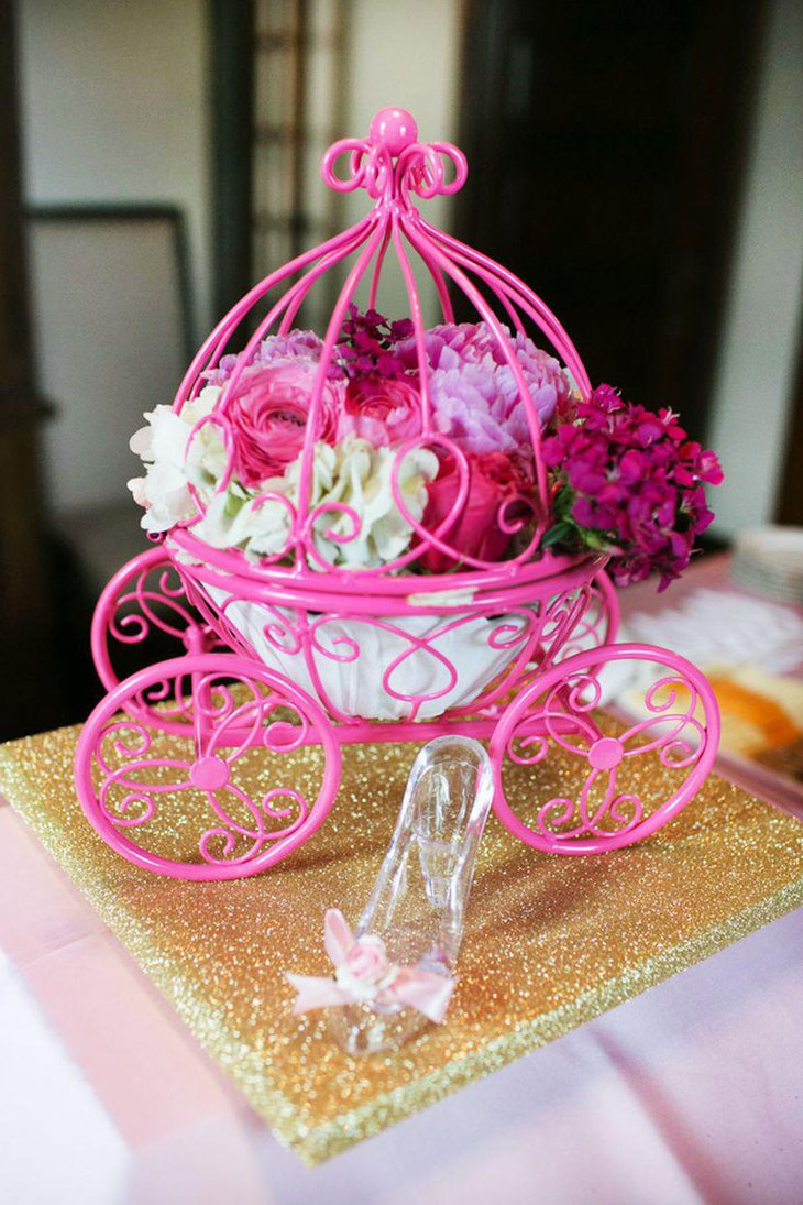 Enchanting floral carriage centerpiece for girl baby shower table