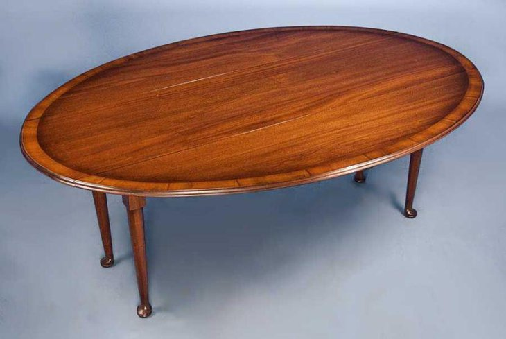 English antique mahogany drop leaf dining table