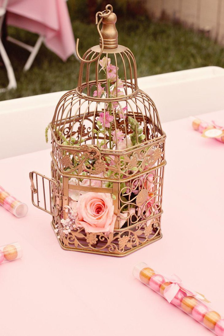 Ethereal golden birdcage centerpiece for summer garden party