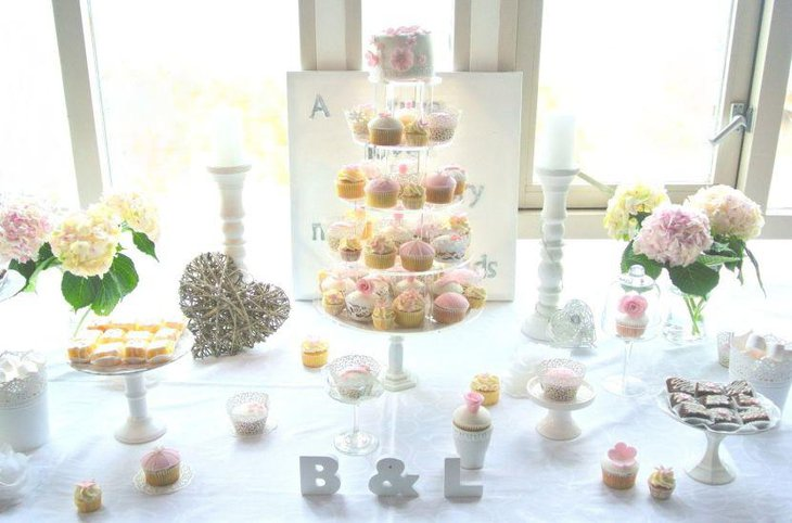 European wedding dessert table with flowers as decoration