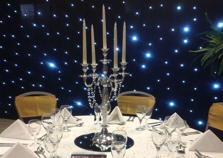 Exotic party table setting with a gorgeous candelabra with crystal garland