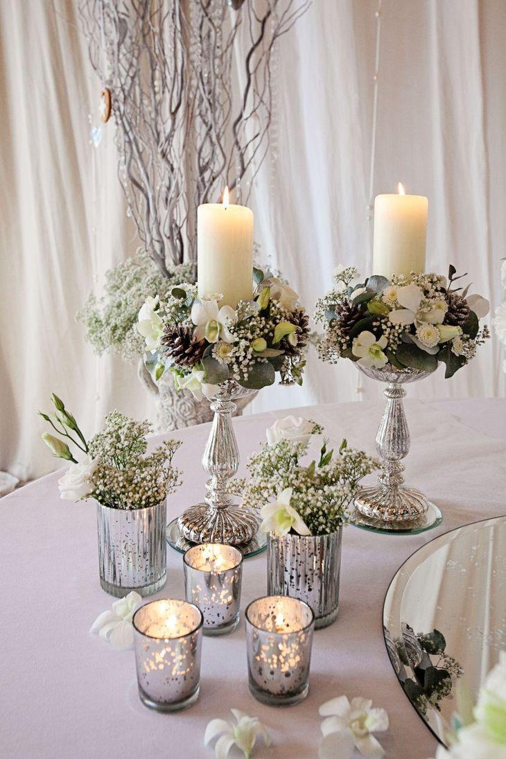 Exquisite winter wedding table decor with silver votives vases and candle holders