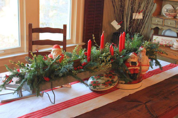 Eye Grabbing DIY Wooden Tray Christmas Table Centerpiece With Candles Santa Figurines and Greens