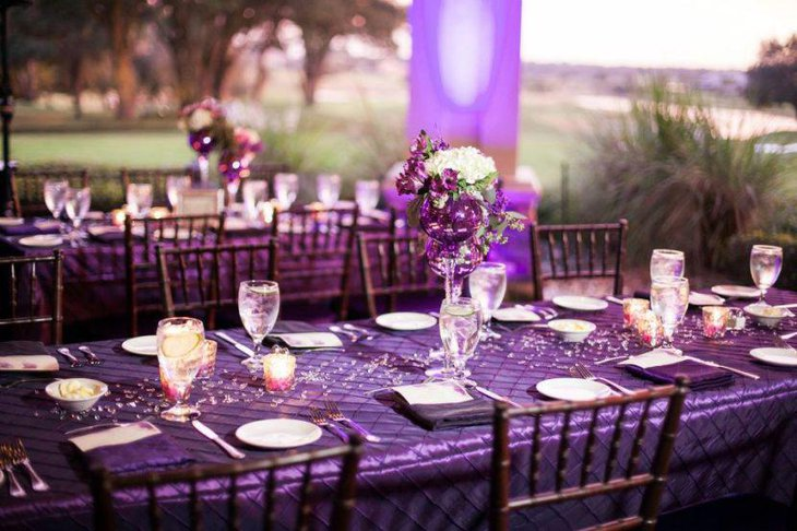 Fabulous outdoor purple themed wedding reception table decor
