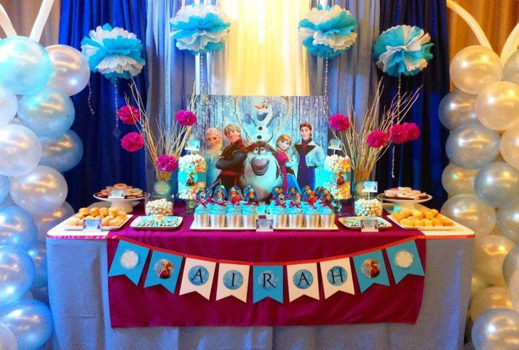 Floral Decor On Frozen Themed Birthday Table For Kids