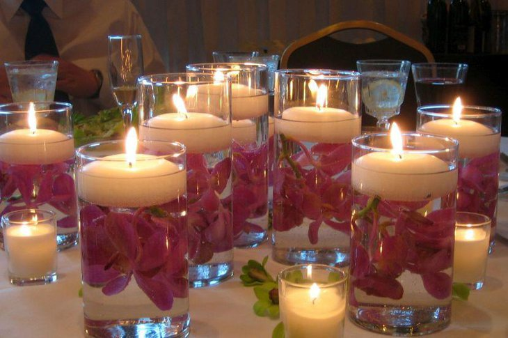 Floral floating candle centerpiece on wedding table