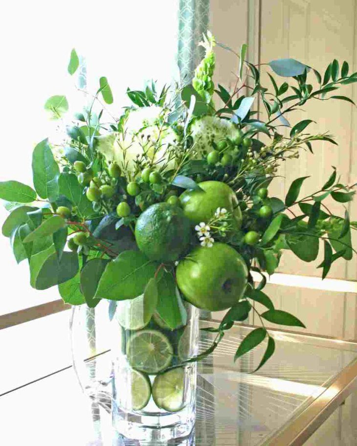 Fruit and leaves in glass vase for St Patricks Day table centerpiece