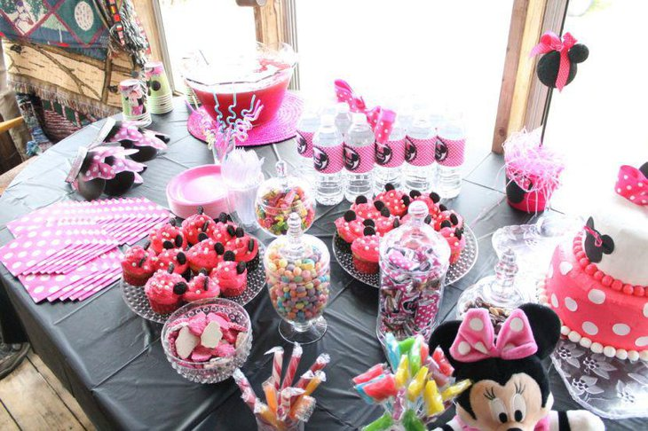 Fun candy table decor with pink and black Minnie Mouse theme